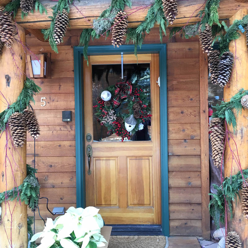 Christmas Decorated Main Door of a Wooden Lodge